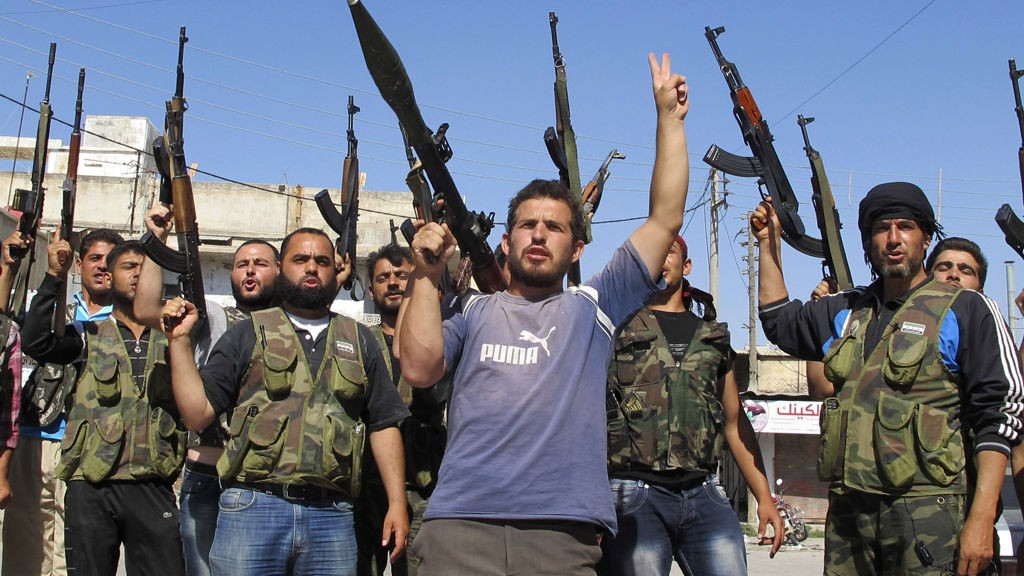 Members of the Free Syrian Army chant slogans against Syrian President Bashar al-Assad in Azzaz