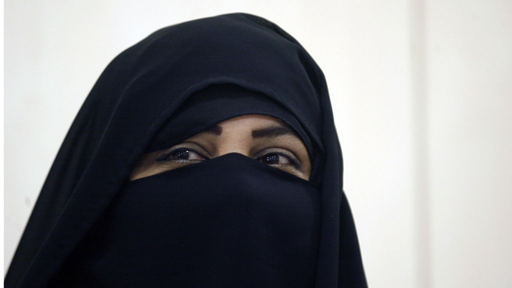 Kuwaiti candidate Thekra al-Majdali, wearing a Niqab Islamic cloth covering, arrives to register for upcoming parliamentary elections, in Kuwait City on December 29, 2011. Kuwait goes to the polls on February 2, 2012.